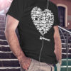 """A black tshirt with a large heart design in the center. The large heart design includes many different types of game controllers. The text """"The Ablegamers Foundation"""" is located at the bottom of the heart."""