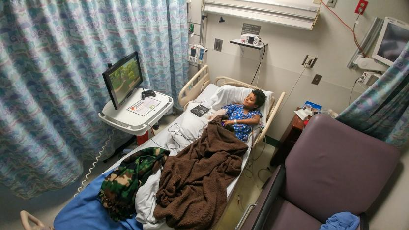 a child playing on a Gamers Outreach Go Kart in a hospital