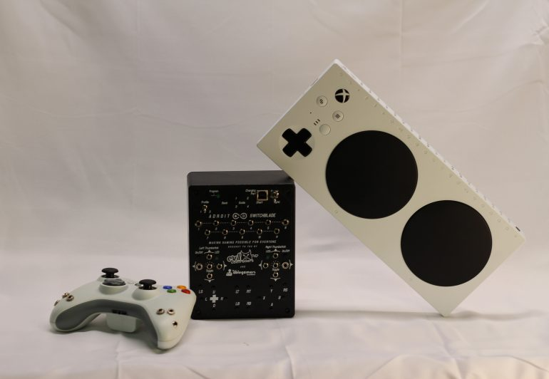 A standard controller, adroit, and Xbox adaptive controller