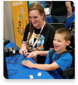 Two people smiling while playing a game.